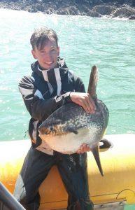 Venture Jet crew holding sunfish