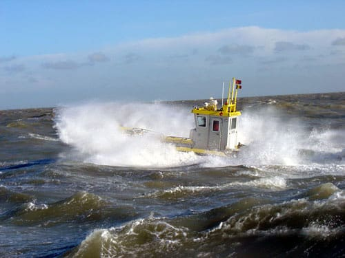 36 year old Ocean Dynamics Ribworker jet boat in rough sea