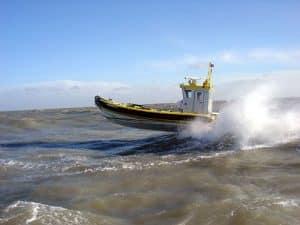 Ribworker jet boat with wheelhouse