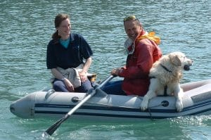 Tim and Beth, owners and skippers at dog friendly Venture Jet, with their golden retriever