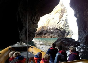 Venture Jet boat exploring Ramsey Island cave St Davids