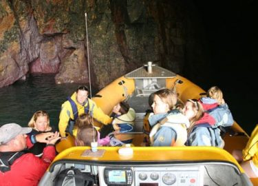 Venture Jet boat deep in pink cave on Ramsey Island Pembrokeshire