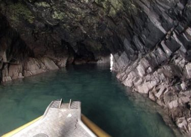 Cave on Ramsey Island Pembrokeshire explored on Venture Jet family activity trip