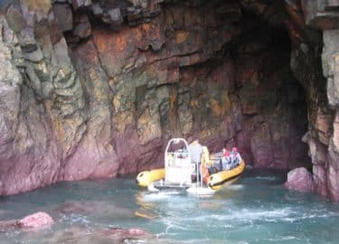 Venture Jet jet boat deep in a cave on Ramsey Island, Pembrokeshire jet boat trip
