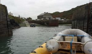 Venture Jet boat and crew dinghy approaching Porthgain harbour (Pembrokeshire, Wales)
